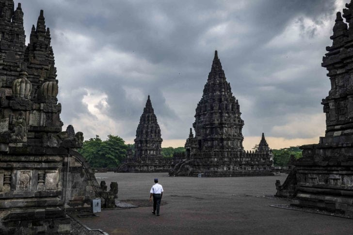 Yogyakarta, Indonesia | Only the buildings needed guarding at a temple complex.